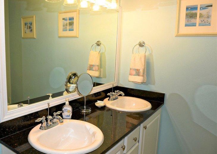 Master en suite has dual sink granite vanity & room for extra storage