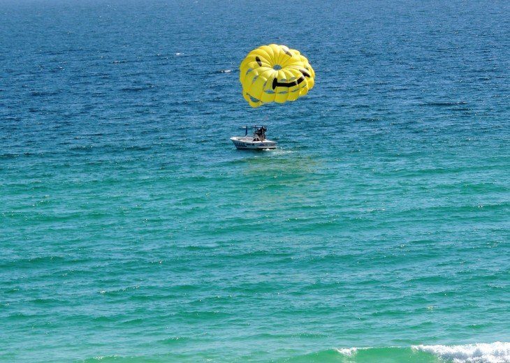 Lots of fun water sports on the Calypso Resort beach front~ parasailing...