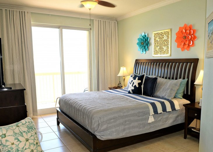 Master bedroom is spacious & has a comfortable king size bed & walk in closet