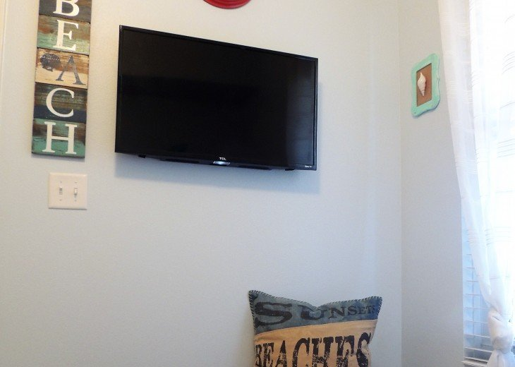 Bunk room wall mounted flat screen TV for private viewing