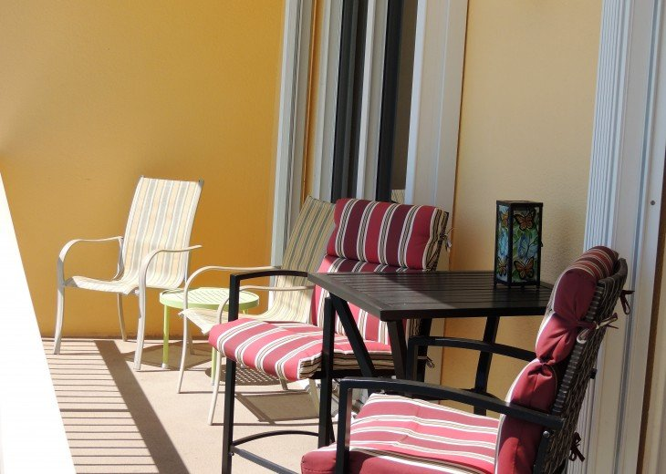 Extra seating on private balcony for entertaining or sitting in peace