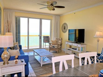 Large flat screen TV in main living area & another view of the balcony access