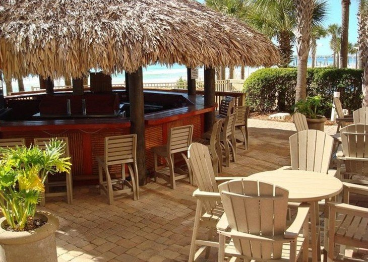 Calypso Resort Tiki bar sits between the 2 beach side pools & beach access