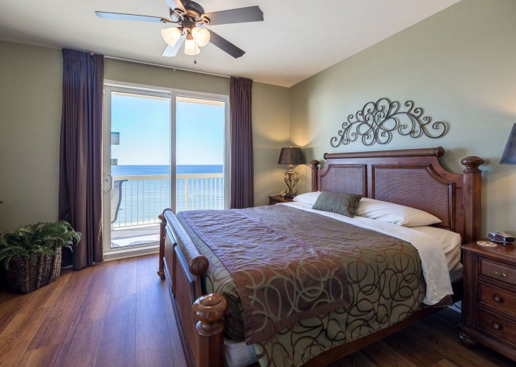 Relaxing master suite with gulf views, private balcony access & king bed