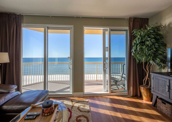Main living sliding doors open to your private large balcony & views of the gulf