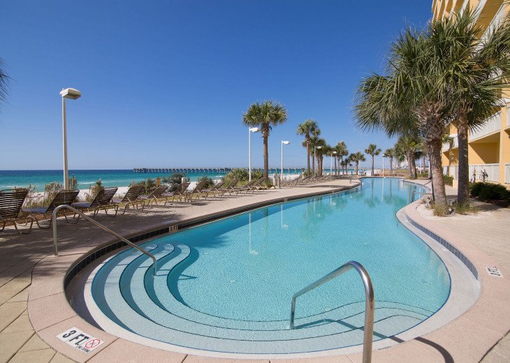 View from the poolside to the west with the Emerald Coast as a backdrop