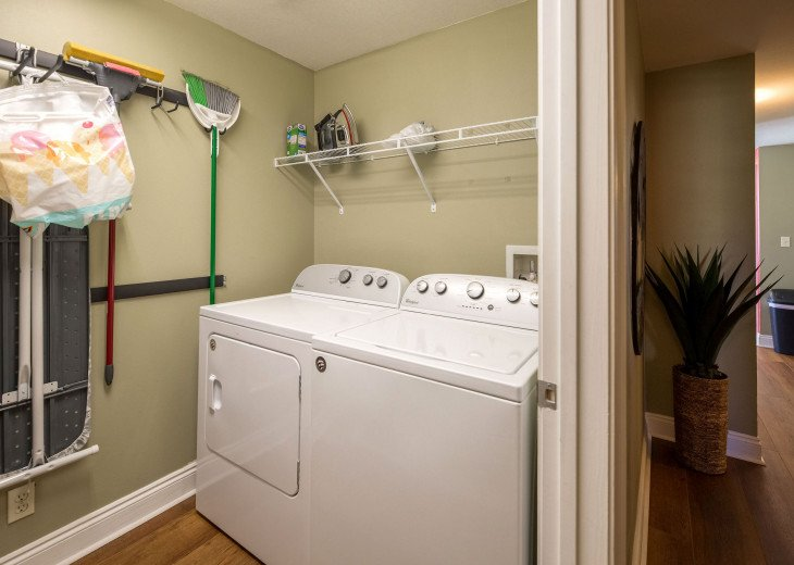 Convenient in unit laundry room w/ full size washer dryer.