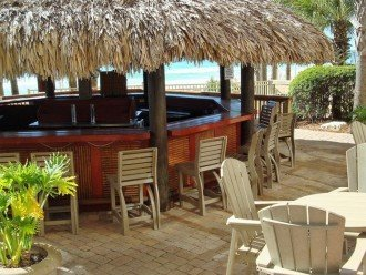 Close up of Calypso Resort Tiki Bar between the 2 Olympic size beach side pools.