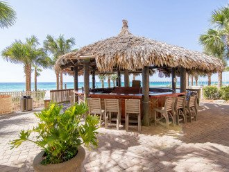 Calypso Resort Tiki Bar located between the 2 beachside pools & the beach access