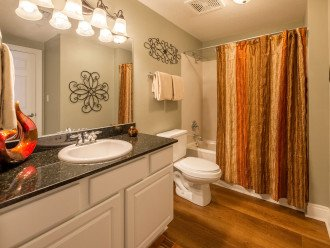 3rd of 3 full bathrooms can be accessed from the hall or 2nd guest bdrm