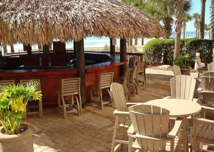 Calypso Tiki bar is located between the 2 beach side pools & beach access