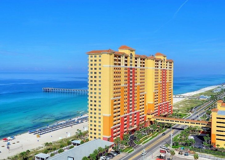Aerial view of the Gulf of Mexico, the white sand beach & Calypso Resort in PCB