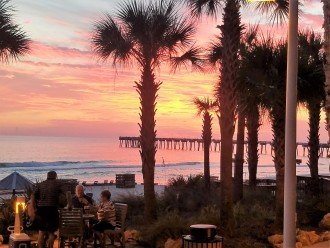 Enjoy the Gulf sunsets by the poolside with friends & cocktails
