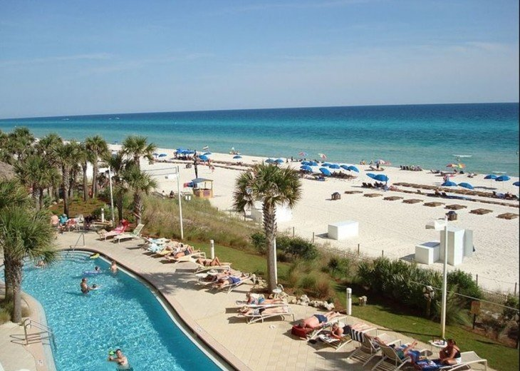 View of 1 of the 2 beach side pools~the beach~& the gulf~ all in 1 picture