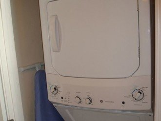 Convenient, in unit stacked washer/dryer~throw a load in & go to the beach!