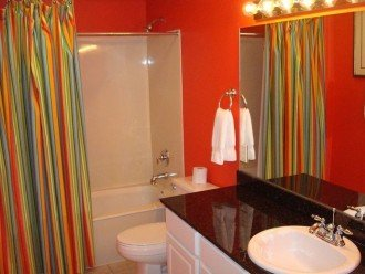The guest bathroom can be accessed from the hall or the 2nd bedroom