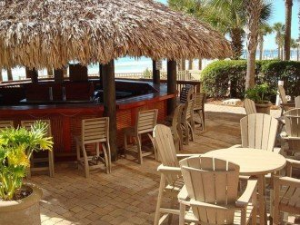 Calypso Tiki Bar sits between the 2 beach side polls & beach access~