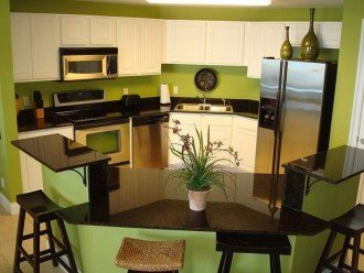 Open concept kitchen is perfect for socializing while cooking & serving meals