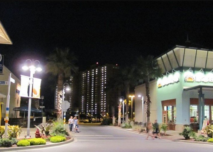 Mid Pier Park at night looking toward Calypso Resort