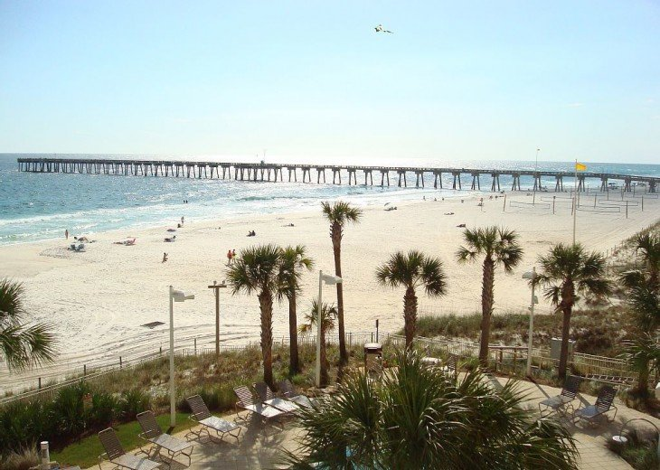 Balcony view to the west with the City Pier, warm white beach & Gulf in view