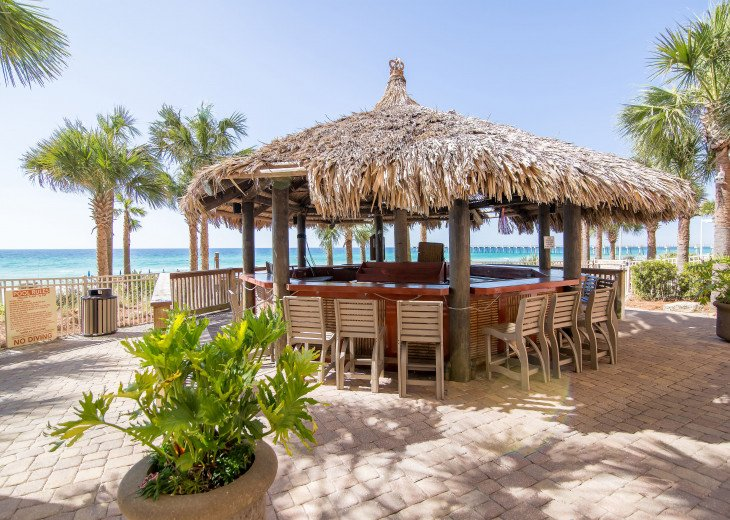 Calypso Resort Tiki bar sits between the 2 beachside pools & the beach access