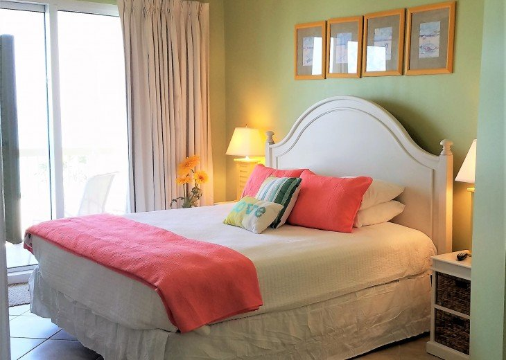 Colorful master suite has a king bed, large walk in closet & en suite bathroom