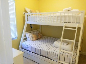 Comfortable bunk room with double bed on the bottom and twin bed on top