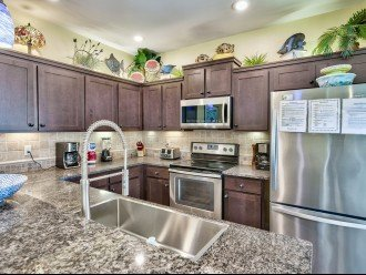 Kitchen with granite, stainless and eat-in breakfast bar