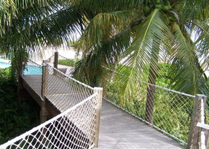Private beach estate. Gated, tropical peace and quiet. Dock #10
