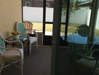 Screen In Porch With Sitting Area And Dinette Table