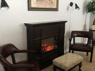 Reading Area In Living Room With Electric Fireplace