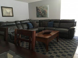 Part Of Living Room With Large Sectional With Three Recliners