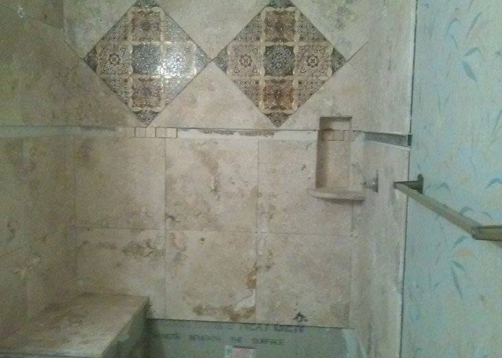 New Bathroom going in ...in Travertine Stone and Custom Tiles..Walk-in shower with seat