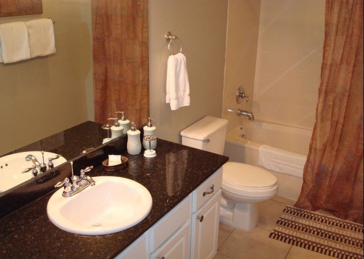 2nd bath large vanity, storage, tub/shower combo w/hall & 1st guest bdrm access
