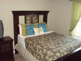 1st guest room has a queen size bed & large closet