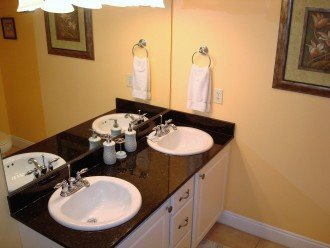 En suite w/dual sink vanity & extra storage space for personal items