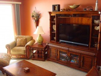 Large flat screen TV in the main living area with extra comfy seating