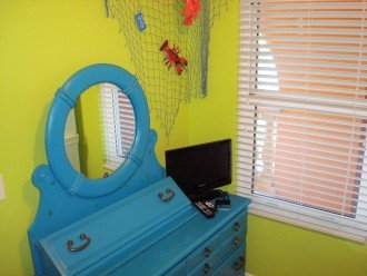 2nd guest bedroom has a dresser & TV for private viewing~what THEY want to watch