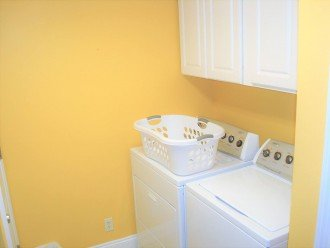 Laundry room with full size washer & dryer~ throw a load in & go to the beach!