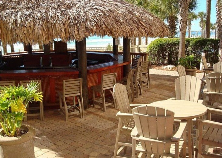 Calypso Tiki Bar sits between the 2 beach side pools & the beach access