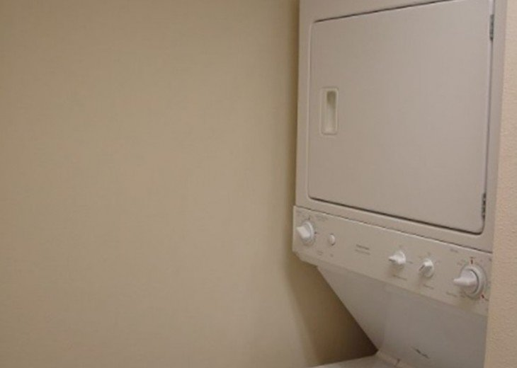 In unit stacked washer & dryer~ perfect to throw in a load & go to the beach
