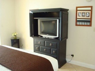 Master has separate TV for private viewing and dresser for extra storage