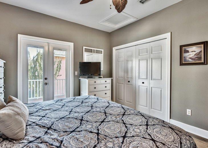 Queen bedroom; balcony access