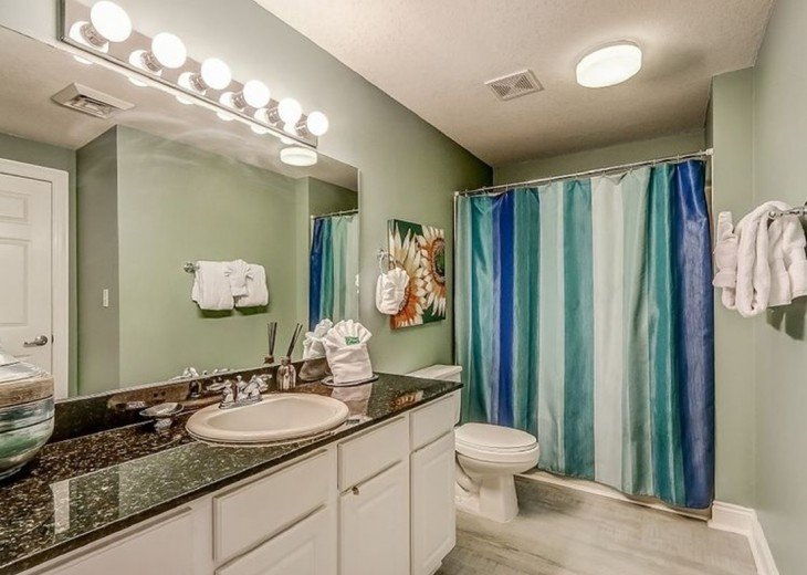 Guest bath has large vanity for extra storage & tub/shower combo