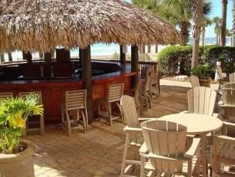 Calypso Resort Tiki Bar site between the 2 beach side pools & beach access