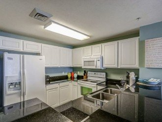 Fully equipped kitchen with granite counters, ceramic cooktop & dishwasher