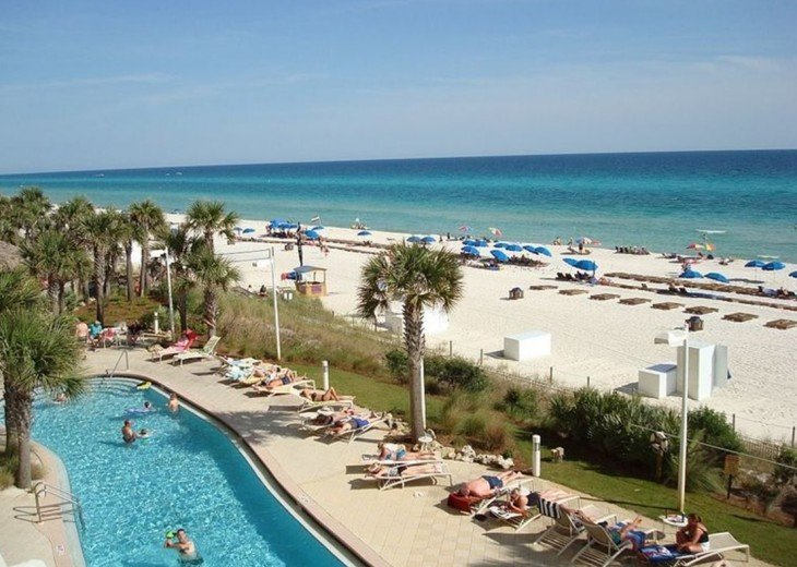 View of how close the pools are to the warm white sandy beach & aqua blue Gulf