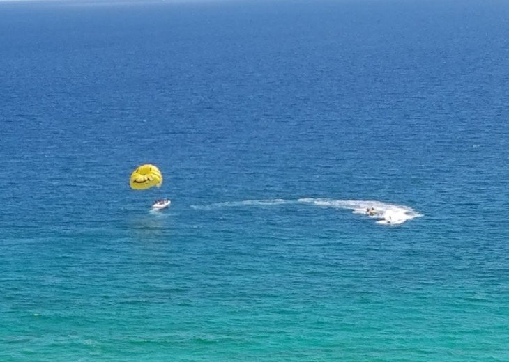 Several fun things to do at Calypso Beach~ there is parasailing...