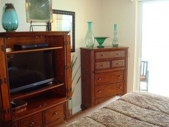 Master bedroom has a separate flat screen TV & dresser for storage