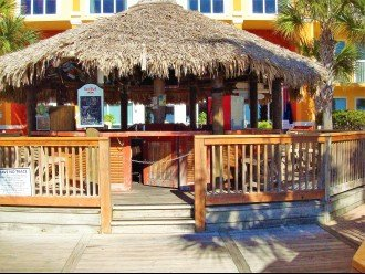 Calypso Tiki Bar sits between the 2 beach side pools & beach access